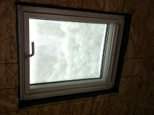 Snow on the skylight.