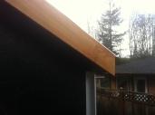 The cedar trim at the gable end.
