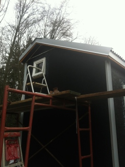Putting up the gable trim.