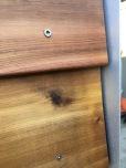 Close-up of cedar lap meeting corner trim.