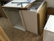 "A 24"" sink cabinet and a 15"" drawer stack."