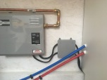 A junction box to conceal the water heater connection.